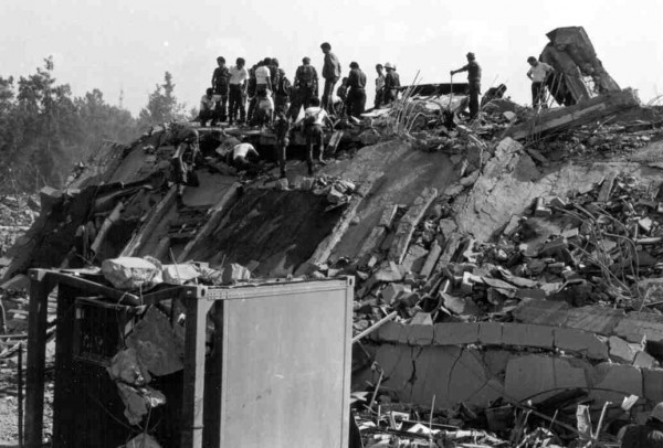 Rescuers search through the rubble of the Marine barracks in Beirut, Lebanon, shortly after an attack on Oct. 23, 1983.