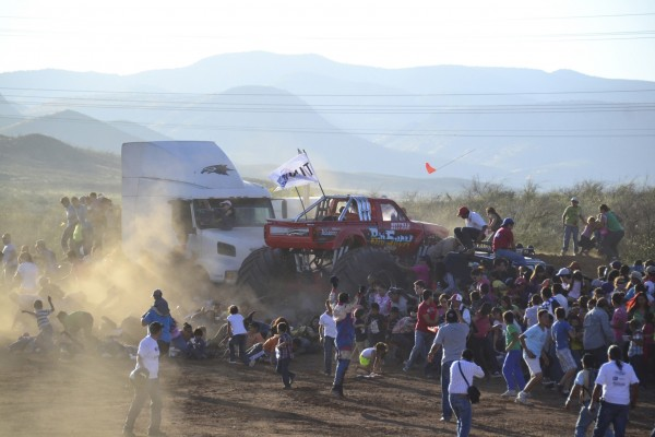 A monster truck drives into spectators during a monster truck rally show at El Rejon park, on the outskirts of Chihuahua Oct. 5, 2013.