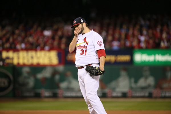 Lance Lynn of the St. Louis Cardinals reacts to walking Xander Bogaerts of the Boston Red Sox to load the bases with no outs during the fifth inning in Game 4 of the World Series on Sunday, October 27, 2013, at Busch Stadium in St. Louis Sunday night.