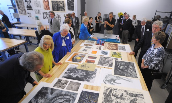 Guests look at prints during the tour of the new Wyeth Family Studio Art Center at the University of Maine in Orono.  The dedication ceremony was held Sunday afternoon.