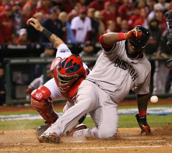 Boston Red Sox's David Ortiz scores on a sacrifice fly by Stephen Drew in the fifth inning during Game 4 of the World Series against the St. Louis Cardinals on Sunday, October 27, 2013, at Busch Stadium in St. Louis Sunday night.