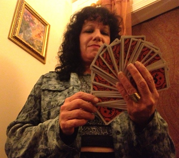 Take your pick. Psychic Pamela Loffredo tells fortunes with a Halloween tarot deck at Leapin' Lizards in Portland.