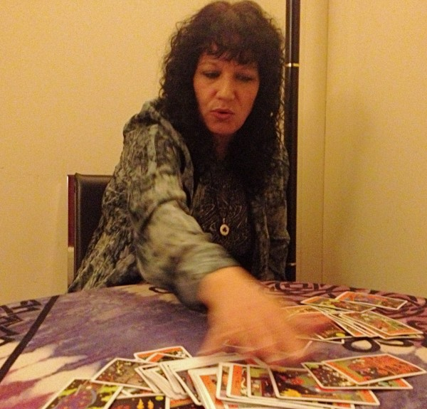 Psychic Pamela Loffredo tells fortunes with a Halloween tarot deck at Leapin' Lizards in Portland.
