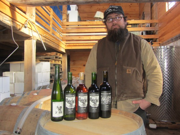 Brian Smith displays the wines being sold by Oyster River Winegrowers of Warren.