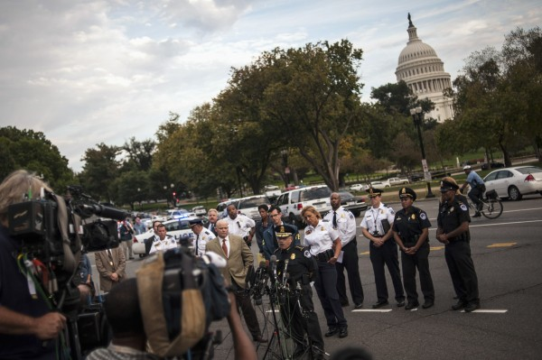 U.S. Capitol Police Chief Kim Dine (bottom, C) addresses reporters on Capitol Hill after a car chase ended in gun fire outside the U.S. Capitol October 3, 2013. A dramatic car chase through the streets of Washington from near the White House to the U.S. Capitol ended in gunfire on Thursday when the driver was shot as lawmakers and aides huddled in a lockdown.