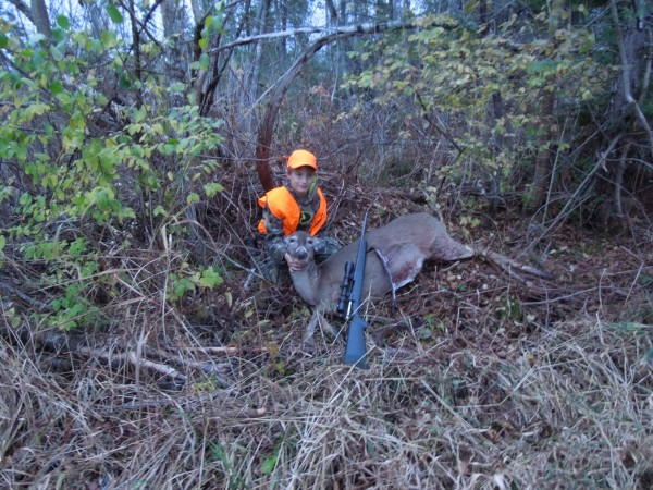 Elijah Matheson, 10, poses with the deer he shot on Youth Deer Day, Oct. 26, 2013, while hunting in Aroostook County with his father, Michael Matheson.