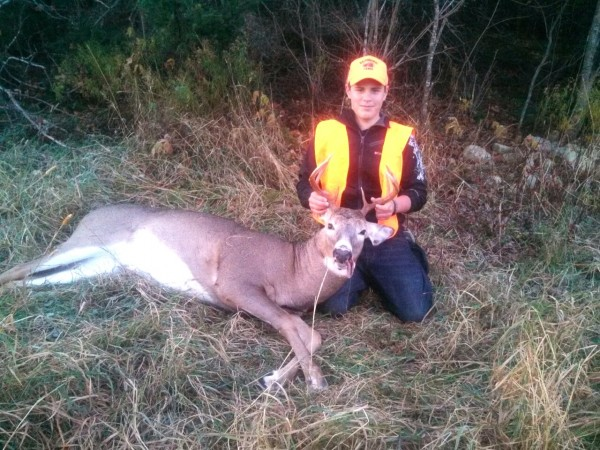 Carter Moir, 13, of Woodland, shot this 10-point buck that weighed in at 202 pounds while hunting on Youth Deer Day, Oct. 26, 2013. He was hunting with his dad, Scott Moir.