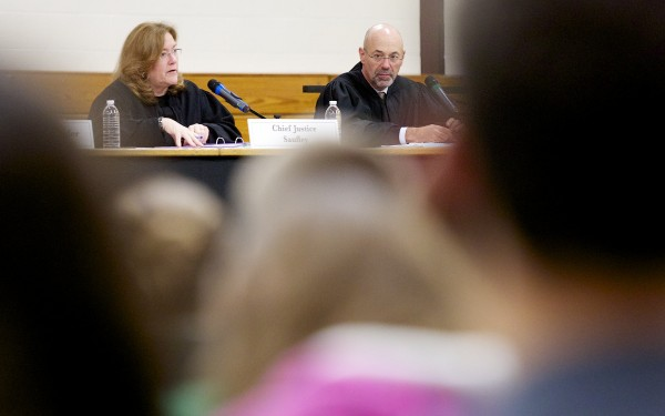 From left, Maine Supreme Court Chief Justice Leigh I. Saufley, Judge Jon D. Levy and other Maine Supreme Court justices listen to an appeal at Nokomis High School Tuesday morning as part of a tour to educate Maine students about the court system.
