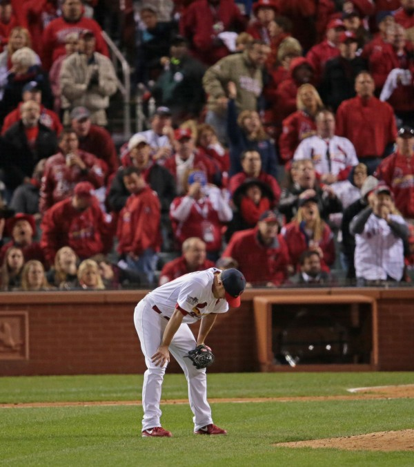 Seth Maness of the St. Louis Cardinals rests his hands on his knees as Jonny Gomes of the Boston Red Sox rounds the bases on a 3-run homer in the sixth inning during Game 4 of the World Series on Sunday, October 27, 2013, at Busch Stadium in St. Louis Sunday night.