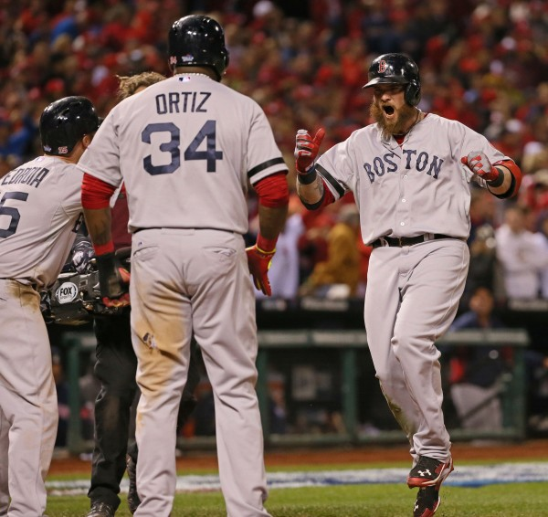 Jonny Gomes of the Boston Red Sox celebrates hitting a 3-run homer with Dustin Pedroia, left, and David Ortiz during the sixth inning in Game 4 of the World Series against the St. Louis Cardinals on Sunday, October 27, 2013, at Busch Stadium in St. Louis Sunday night.