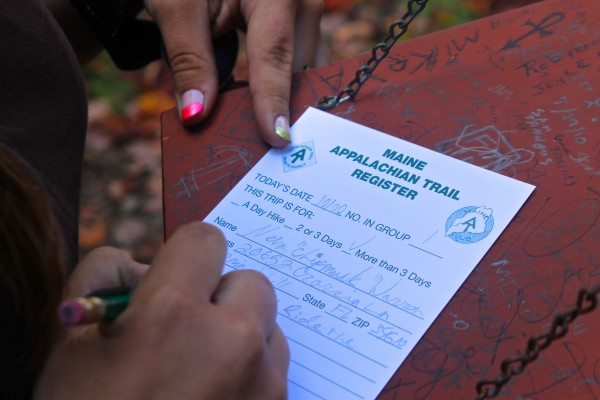 Neva &quotChipmunk&quot Warren, 15, of Florida signs an Appalachian Trail register before hiking north on the Appalachian Trail on Oct. 3 in Monson in an effort to become the youngest solo thru-hiker of the trail.