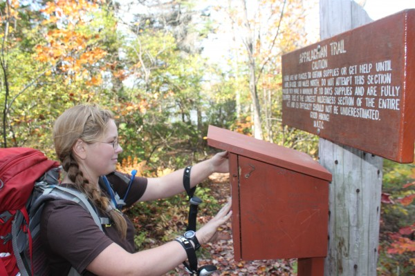 Neva &quotChipmunk&quot Warren, 15, of Florida signs an Appalachian Trail registry on Oct. 3 in Monson before hiking north on the trail in an effort to become the youngest solo thru-hiker of the trail.