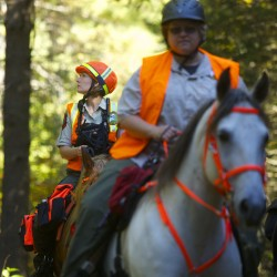 Sharon Kenney Pomeroy, left, looks out into the woods while doing a mock search in LaGrange. Maine Mounted Search and Rescue helps to locate lost, abducted, or missing persons in the state of Maine while utilizing the many benefits that riding horseback can bring to searches.