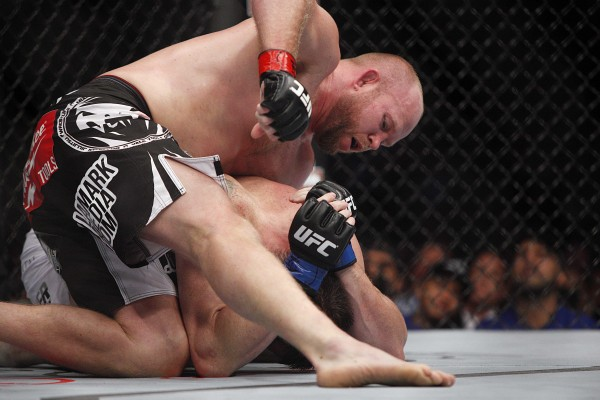 Tim Boetsch (red gloves) fights against C.B. Dollaway (blue gloves) in their middleweight bout during UFC 166 at Toyota Center in Houston Saturday night.