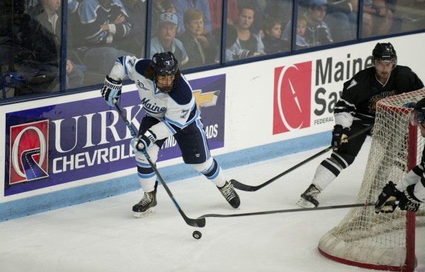 he University of Maine's Ryan Lomberg takes possession of the puck behind the Dalhousie University goal Sunday at Alfond Arena in Orono. Lomberg scored a goal in Maine's 5-1 win.
