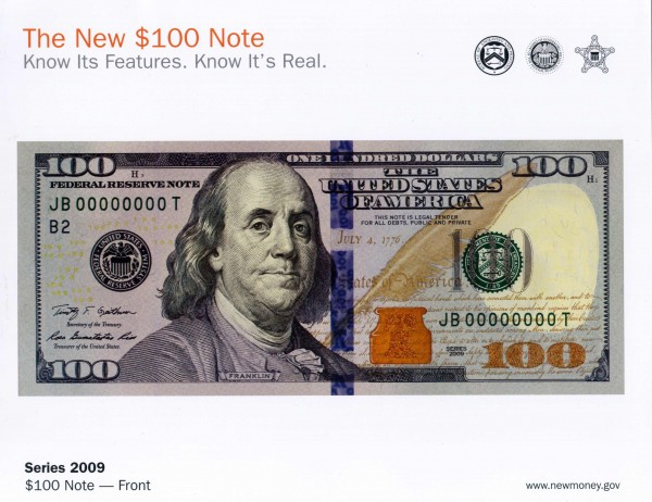 The new U.S. $100 bill is seen in this handout photo provided by the Federal Reserve Bank of Philadelphia October 8, 2013. The notes, which retain the image of American statesman and scientist Benjamin Franklin, include two new security features - a blue three-dimensional security ribbon with images of bells and 100s, and a color-changing bell in an inkwell, the Fed said in a statement.