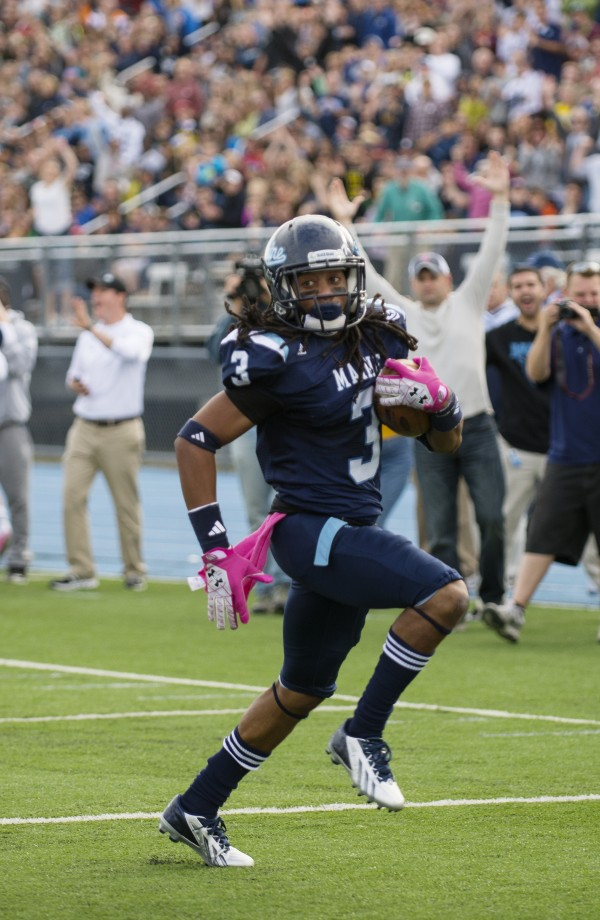 The University of Maine's Sherrod Baltimore goes in for a touchdown during the first quarter of Saturday afternoon's home game against the University of Delaware. Baltimore recovered a fumble and returned it 20 yards for the TD in Maine's 62-28 victory.