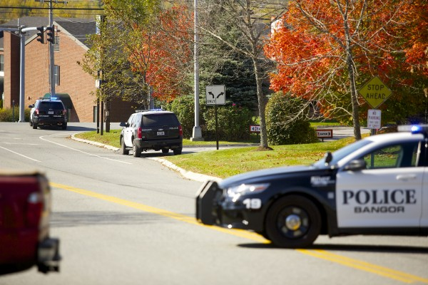 Traffic was rerouted around a section of Hogan Road where a suspicious package was found Monday morning in the Dunkin' Donuts parking lot.
