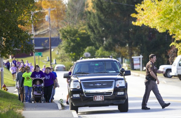 People participate in a Womancare's race and walk to end abuse in Guilfordon Oct. 6 as part of domestic violence awareness month.