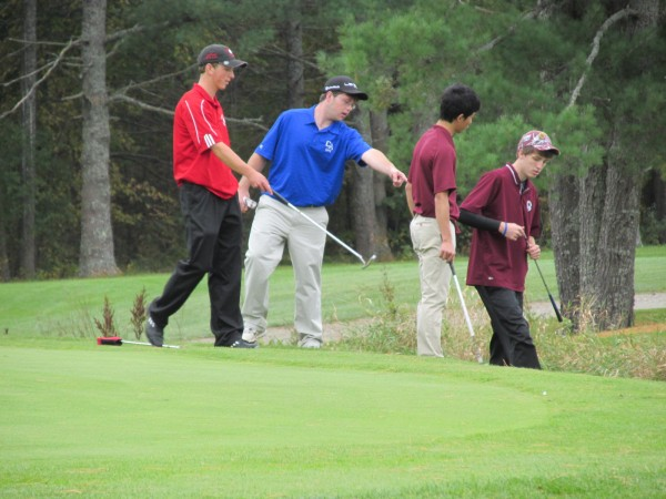 Robbie Watson of Fort Fairfield (from left), Alex Folsom of Central Aroostook and C.J. Chen of George Stevens Academy help Buckfield's Jonah Williams (right) find his ball near the hazard during Saturday's Maine high school golf state championships at Natanis Golf Course in Vassalboro. Camden Hills, Falmouth and St. Dominic Academy of Auburn won the team titles.