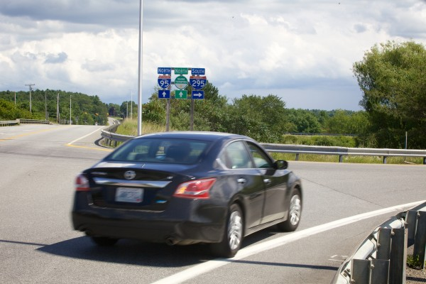 A car leaves the Lewiston Road (Routes 126 and 9) and heads south on Interstate 295. Directly opposite this ramp, across the Lewiston Road is the Interstate 295 southbound offramp.
