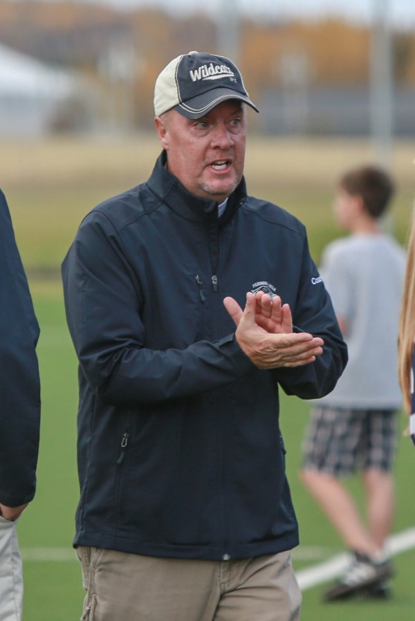 Presque Isle High School girls soccer coach Ralph Michaud cheers on his team during its 1-0 victory over the Old  Town Coyotes Saturday, Oct. 12 in Presque Isle. It was the 200th career coaching victory for Michaud.