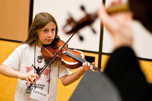 Kathleen Spear, a fifth-grader at Ocean Avenue Elementary School in Portland, looks toward teacher Ashley Terison while playing viola in a stringed instrument class. Music instruments are in short supply and high demand throughout the Portland Public Schools, where as many as 25 percent of income-qualified students who want to learn an instrument are turned away. Several music teachers are hosting an instrument donation drive from 9 a.m. to noon Saturday, Oct. 26, at Lincoln Middle School, 522 Stevens Ave.