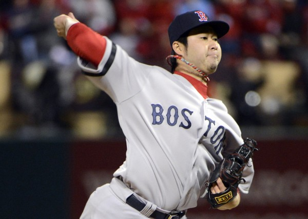 Boston Red Sox relief pitcher Junichi Tazawa throws a pitch against the St. Louis Cardinals in the seventh inning during game three of the World Series at Busch Stadium.