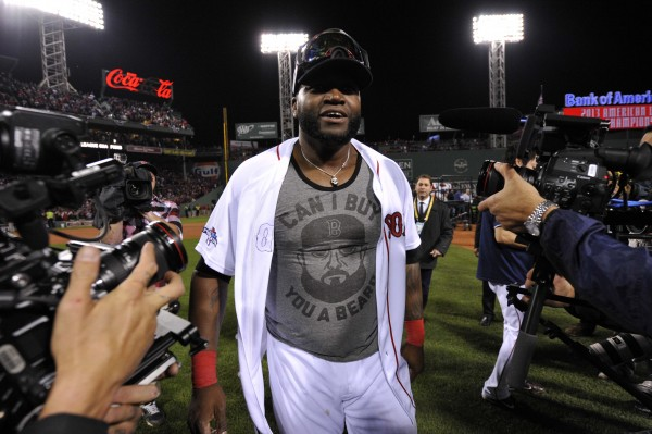 Boston Red Sox designated hitter David Ortiz walks off the field after defeating the Detroit Tigers in game six of the American League Championship Series Saturday night in Boston.
