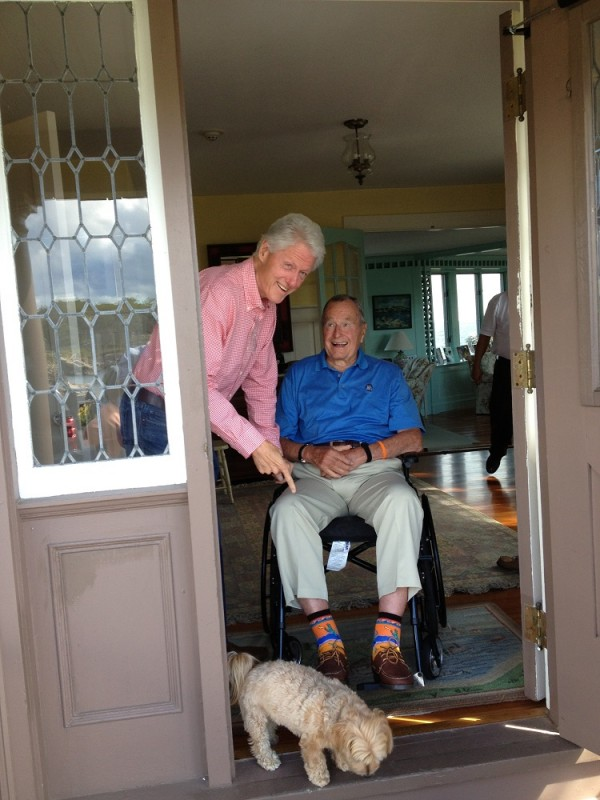 Former presidents Bill Clinton and George H.W. Bush get a laugh out of Bush's colorful socks after a September lunch together in Kennebunkport.