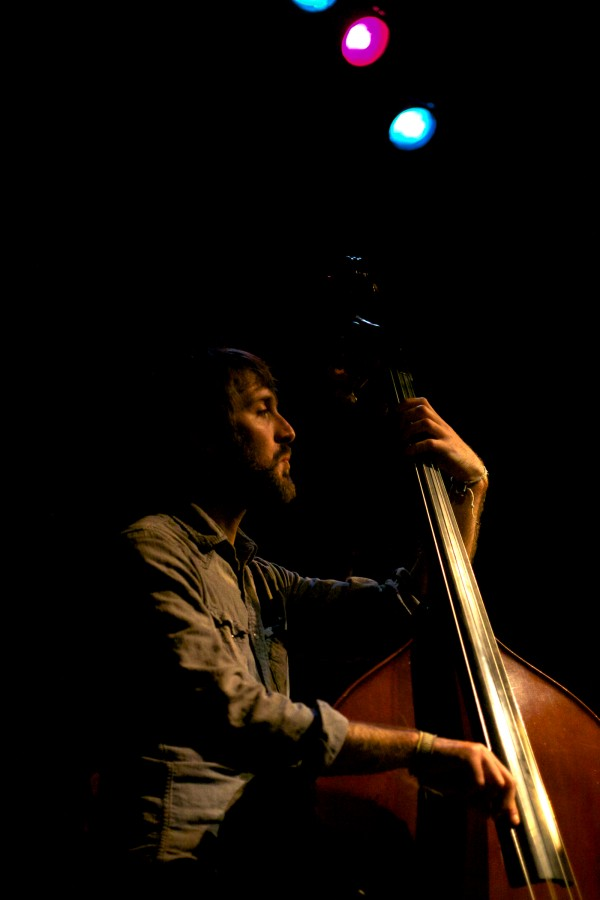 Bassist Colin Winsor plays a set with singer and songwriter Connor Garvey at One Longfellow Square Sunday night.