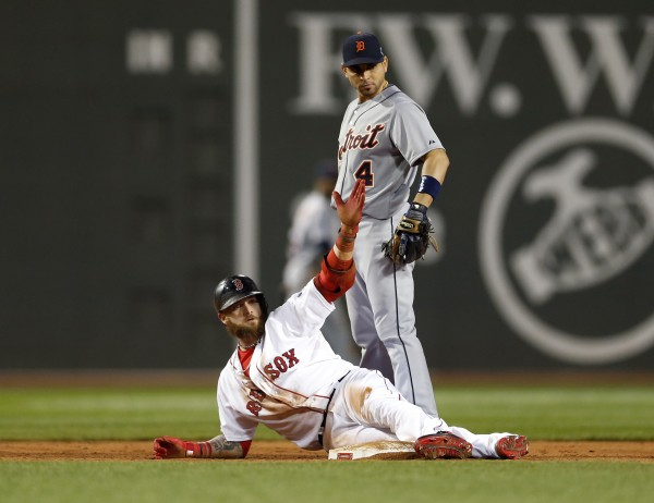 Boston's Jonny Gomes (bottom) slides into second base with a double ahead of Detroit Tigers second baseman Omar Infante (4) during the seventh inning in game six of the American League Championship Series Saturday night in Boston.