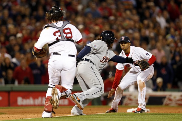 Detroit's Prince Fielder (middle) is caught in a rundown between Boston Red Sox catcher Jarrod Saltalamacchia (39) and third baseman Xander Bogaerts in game six of the American League Championship Series Saturday night in Boston.