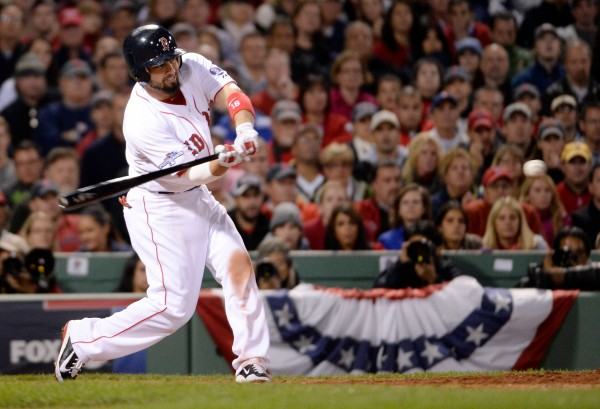 Boston Red Sox right fielder Shane Victorino hits a grand slam against the Detroit Tigers during the seventh inning in game six of the American League Championship Series Saturday night in Boston.
