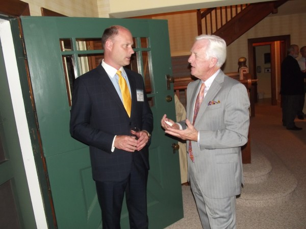 Trevor Holder (left), New Brunswick's tourism minister, speaks with Dana Connors (right), president of the Maine State Chamber of Commerce, at the Maine Association of Chamber of Commerce Executives conference at Roosevelt Campobello International Park on Wednesday evening.
