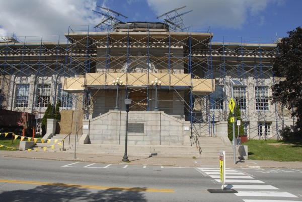 Construction scaffolding encases the Bangor Public Library as work proceeds on a new copper roof and other updates.