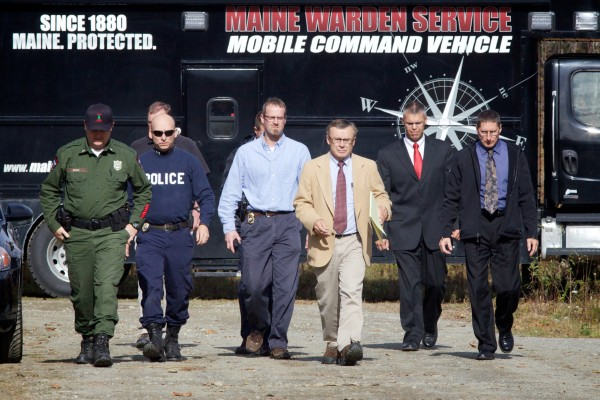 State police spokesman Stephen McCausland (tan jacket) and other law enforcement officials approach the media on Nike Lane in Oakland Wednesday, where a renewed search for missing toddler Ayla Reynolds came up empty.