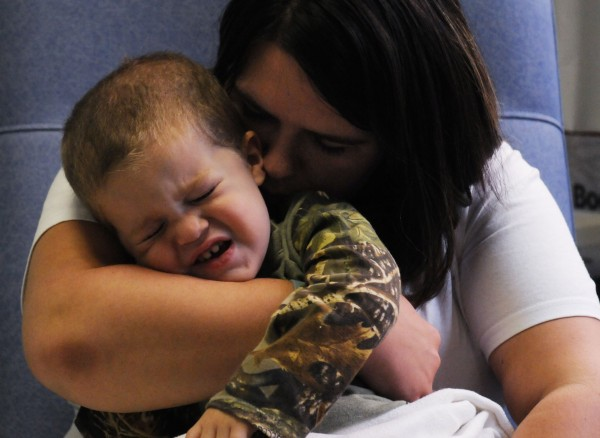 Two-year-old cancer patient Tripp Murray is comforted by his mother Kim Tripp after a procedure at Eastern Maine Medical Center in Bangor on Tuesday.