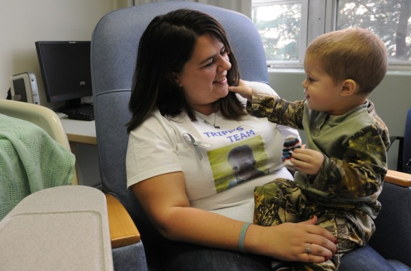 Two-year-old cancer patient Tripp Murray plays with Kim Tripp's hair as the mother and son wait for Tripp to have a procedure at Eastern Maine Medical Center in Bangor on Tuesday.