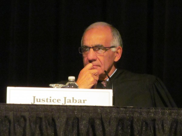 Maine Supreme Judicial Court Justice Joseph Jabar contemplates a case being argued at Cape Elizabeth High School Wednesday. The high court continued its annual series of school appearances in the southern Maine town Wednesday after visits to Orono and Nokomis high schools earlier in the week.
