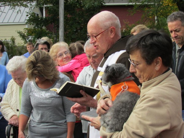 The Rev. Peter Kaseta blesses pets outside Sacred Heart Church in Yarmouth on Saturday, Oct. 5, in honor of St. Francis of Assisi's Feast Day.