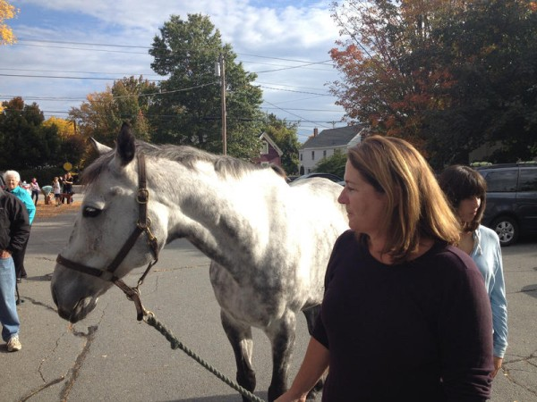 Jennifer Crosby of Cumberland brought her horse, Miles, to Saturday's blessing of the animals in Yarmouth.