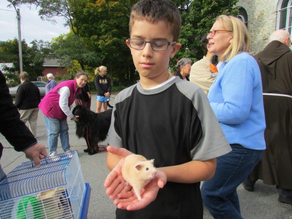 Andrew Beaulieu, 10, of Gray, brought his hamster Tim to the blessing of the animals at Sacred Heart Church in Yarmouth on Saturday, Oct. 5, 2013.
