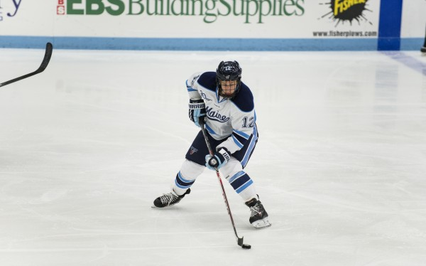 The University of Maine's Bill Norman takes control of the puck during the second period against Dalhousie University at the Alfond Arena in Orono Sunday.