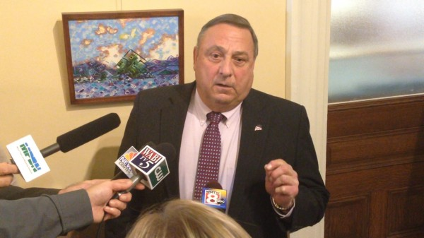 Gov. Paul LePage speaks with reporters outside his office at the State House on Thursday, Oct. 10.