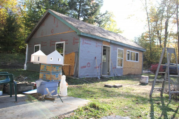 The formerly abandoned garage that is being converted into a home by Jennifer Jacques seen in October 2013. In the foreground is a model for the house created by Jacques' daughter, Asha.