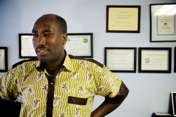 eorges Budagu Makoko, an award-winning property manager for the nonprofit Avesta Housing, stands in his Gorham office Wednesday amid certificates marking his achievements. He details his life and harrowing escape from Congo and Rwanda in a new book.