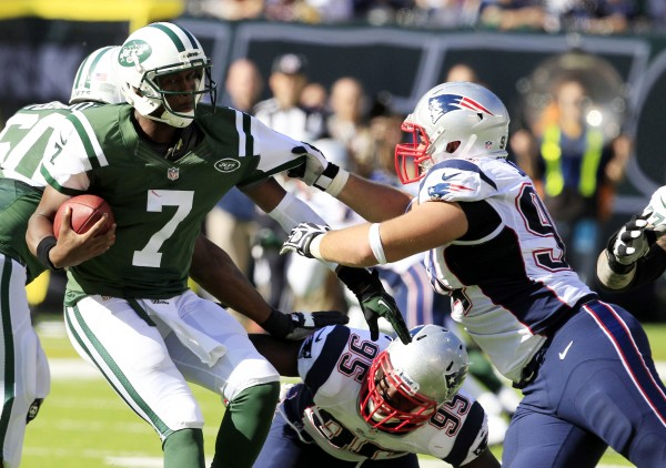 New York Jets quarterback Geno Smith (7) is sacked by New England Patriots defensive tackle Chris Jones (94) at MetLife Stadium in East Rutherford, N.J., Sunday.