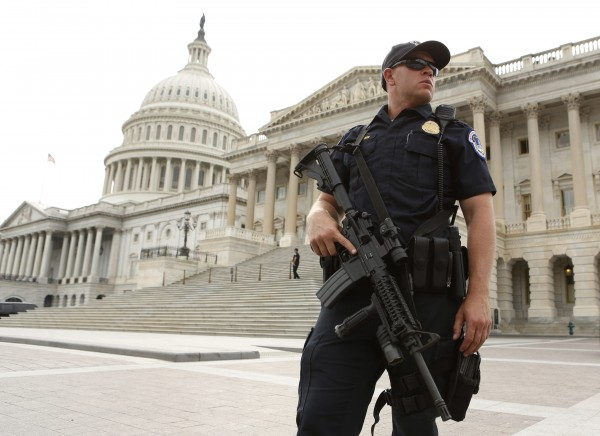 A U.S. Capitol Police officer stands guard  after a shooting near the U.S. Capitol on Thursday.