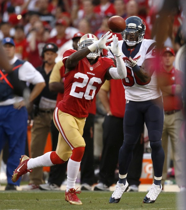 San Francisco 49ers' Tramaine Brock (26) intercepts the ball against Houston Texans' Andre Johnson (80) during the second quarter at Candlestick Park in San Francisco Sunday night.